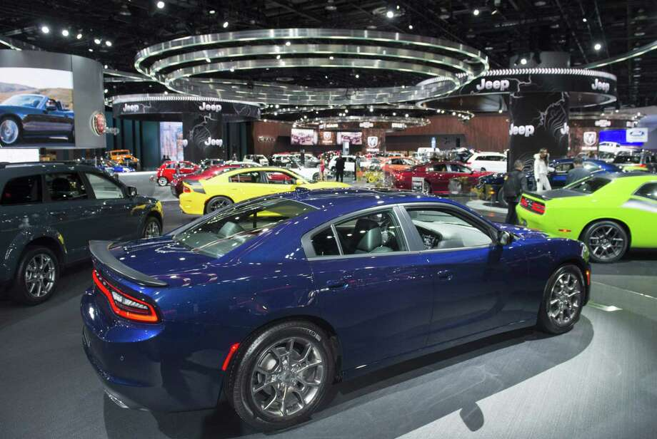 This year's North American International Auto Show reflects an industry that's flush with cash but uncertain about the future. Photo: Saul Loeb /AFP /Getty Images / AFP or licensors