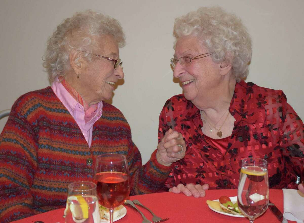 Sisters-in-law Arlene Hulton, left, and Thelma Aldrich share lighthearted conversation at the start of Water Witch Hose Co. # 2's annual dinner held Jan. 6 at the United Bank Building at 19 Main St. in New Milford.