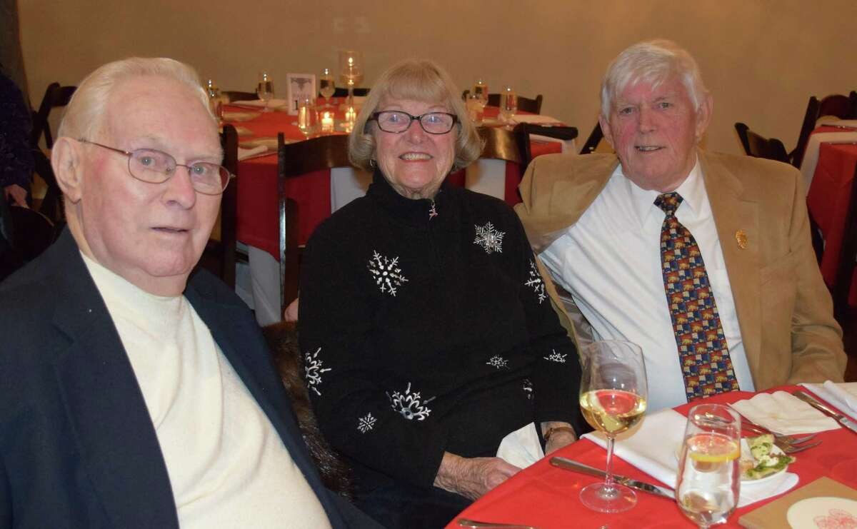 Spectrum/Art Carlson, 90, left, and his brother and sister-in-law, Robert, 84, and Pearl Carlson, enjoy the festivities at Water Witch Hose Co.#2's annual dinner held Jan. 6, 2017 at the United Bank Building, 19 Main St., New Milford. Art and Robert each joined the department at 21.