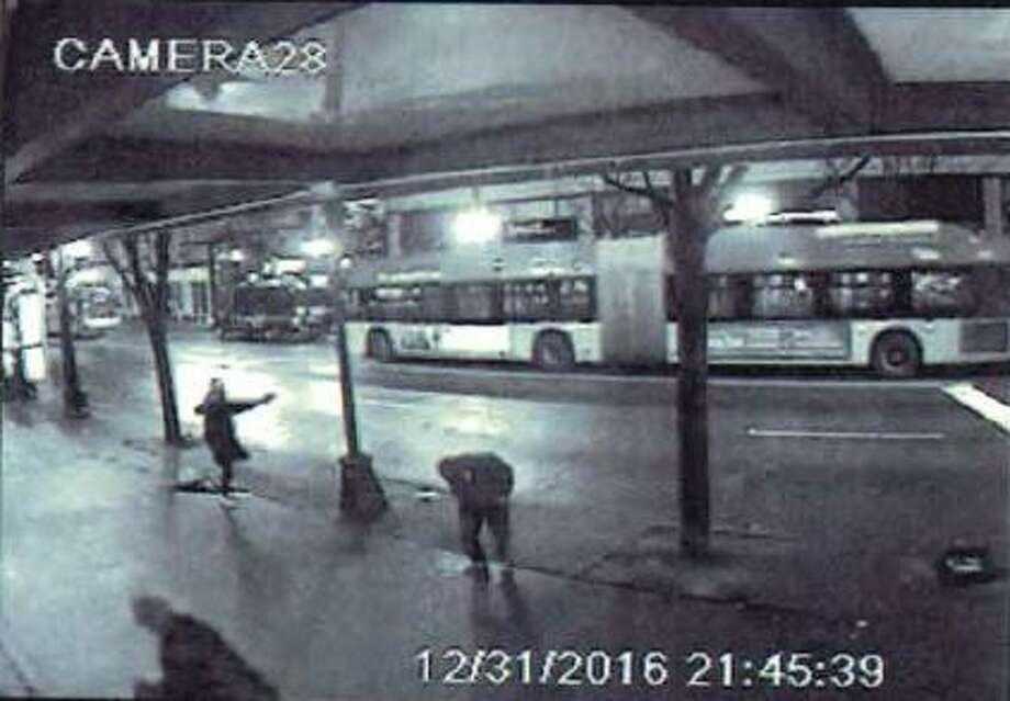 Surveillance footage taken from the Third and Pine McDonald's appears to show a gunman firing at a car ahead of him and a 28-year-old victim of the gunfire recoiling in pain. Jeffrey Joseph Thomas was charged with first-degree assault last week for the shooting. Photo: Courtesy King County Prosecutor's Office