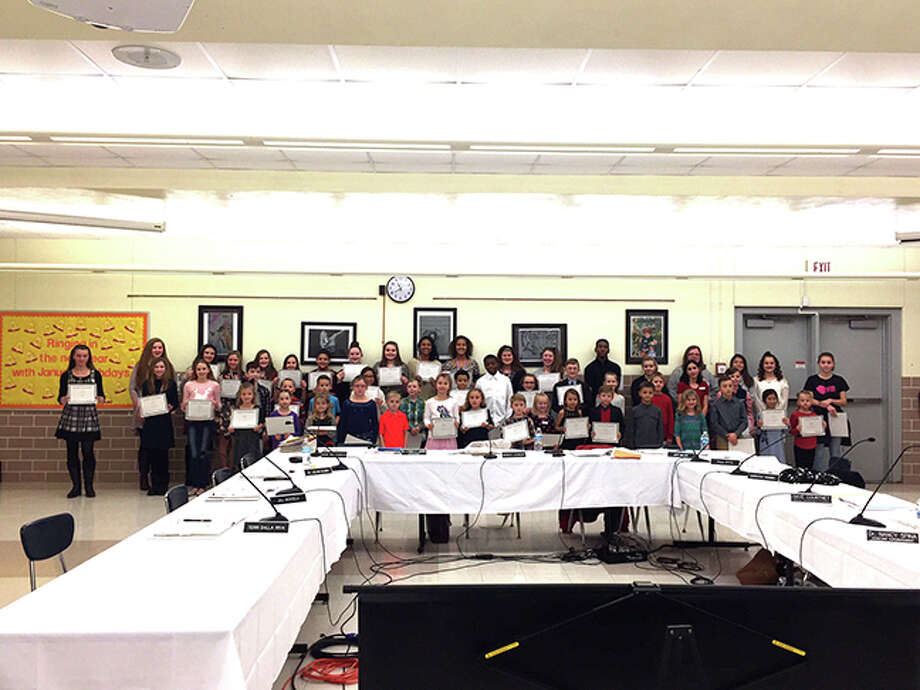 Winners of Edwardsville District 7 Do The Right Thing Awards for January were recognized at the Jan. 9 Board of Education meeting. They were: Tayler Fusaro, Guy Brown, Erynn Colligan, Alex Joseph, Ellery Tyrrell, Shelby Saye, Hannah Beck, Annabell Ambuel, Matt Zollner, Donovan Booker and Montrice Spencer from Edwardsville High School; Kennedy Fox, Madison Trimm, Sydney Harris, Ariana Bennett, Elle Evans, Alexis Trimm, Alexis Bond, Violet McNece, Kaitlyn Conway, Kate Conner, Macy Silvey, Grace Daech, Ashlyn Hauk, Zoey Kue and Claire Dunivan from Liberty Middle School; Anastacia Muratov, Rachel Piazza, Tyler Dacus and Alene Hanks from Lincoln Middle School; Leila Westra, Elise Schwartz and Miller Dunnill from Glen Carbon Elementary; Avery Bruch, Christian Podstawa and Vincent Skenderi from Goshen Elementary; Keira Wehrle, Elliana Moody and Kaylee Huston from Leclaire Elementary; Elliott Huff, Allison Schwartz and Destiny Taylor from Hamel Elementary; Tucker Sanderson, Orissa Steiner and Emma Henson from Midway Elementary; Amalie Hawk, Kaitlyn Mapel and Nola Slagle from Nelson Elementary; Elijah Huniak, Charlotte Welch and Cash Vereeke from Worden Elementary; Isabella Russo, Gino Montgomery III, and Xavier Hornberger from Columbus Elementary; William O'Boyle, Layne Logan and Anna Hill from Woodland Elementary; and Santiago Sanchez, Noah Lewis and Scott Rapien from Cassens Elementary. Photo by Julia Biggs. Photo: Julia Biggs • Intelligencer