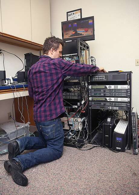 Keith Leitch gets ready to upgrade the emergency alert equipment at KKPM-TV in Santa Rosa. Photo: Liz Hafalia, The Chronicle