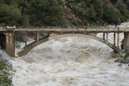 Old Route 49 bridge crossing over the South Yuba River in Nevada City, Calif. saw local and regional visitors during the atmospheric river event across Northern California on January 9, 2017.   Kelly M. Grow/ California Department of Water Resources