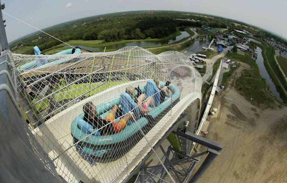 """Riders go down the water slide called """"Verruckt"""" at Schlitterbahn Waterpark this summer in Kansas City, Kan. The family of Caleb Schwab, a Kansas lawmaker's son who was killed Aug. 7 on the ride, has reached a settlement with the park's owner. Photo: Charlie Riedel /Associated Press / Copyright 2017 The Associated Press. All rights reserved."""