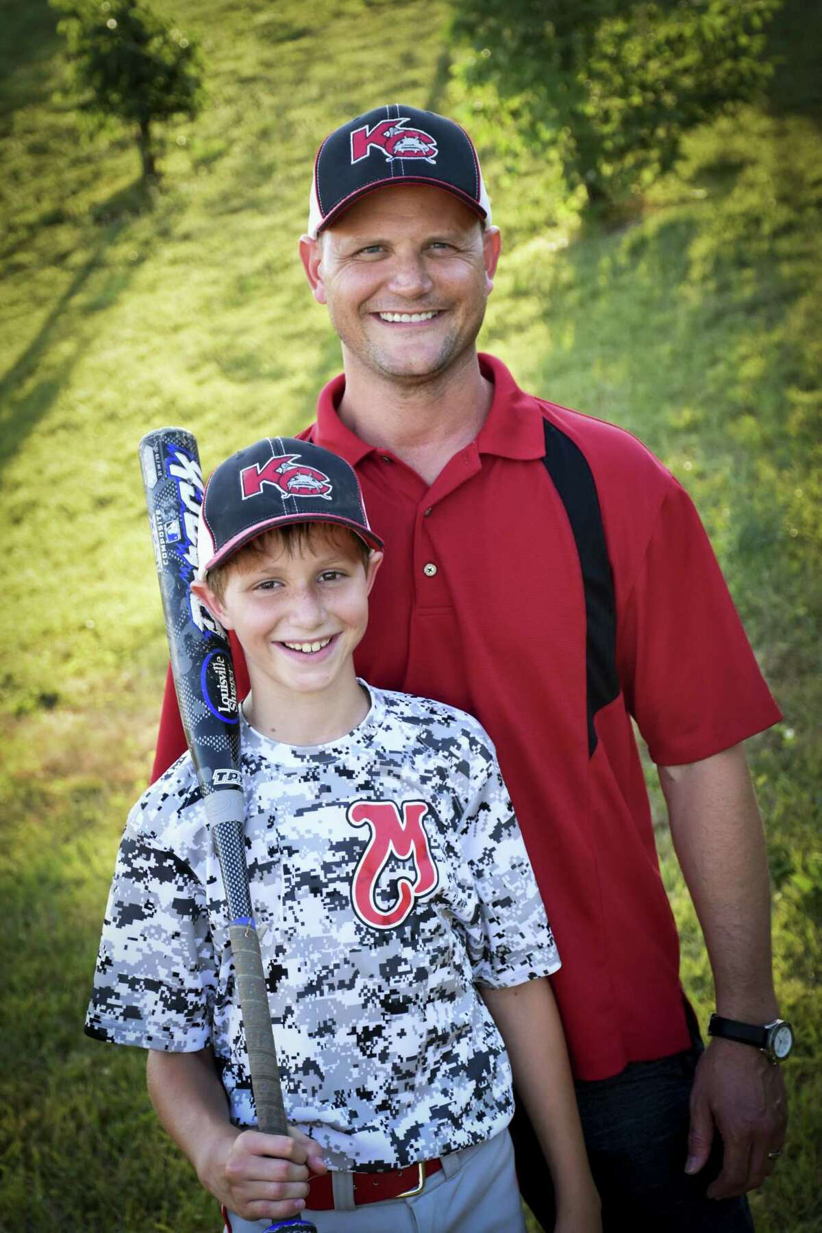 Caleb Scwhab, 10, was killed on the water slide on Aug. 7, 2016. His father, Republican state representative Scott Schwab, is pictured on the right.