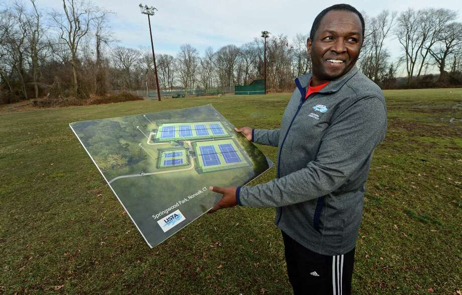 Norwalk Grassroots Tennis Director David Kimani points out potential locations for new tennis courts Wednesday, Jan. 11, at Nathaniel Ely School on Ingalls Avenue in Norwalk. The Norwalk Common Council approved accepting at least $400,000 in donated fund to create the William Rippe Tennis Center behind Nathaniel Ely School Tuesday evening after lengthy discussion on how the tennis courts would mesh with the Board of Education's plan to build a new school there. Photo: Erik Trautmann / Hearst Connecticut Media / Norwalk Hour