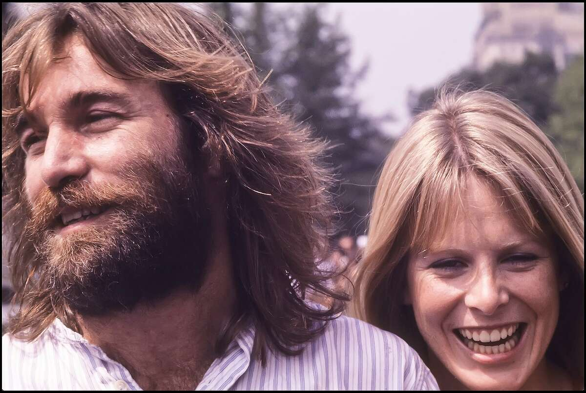 American musican Dennis Wilson, of The Beach Boys, and his wife, actress Karen Lamm, prior to a performance at a free concert on the Great Lawn of Central Park, New York, New York, September 1, 1977.