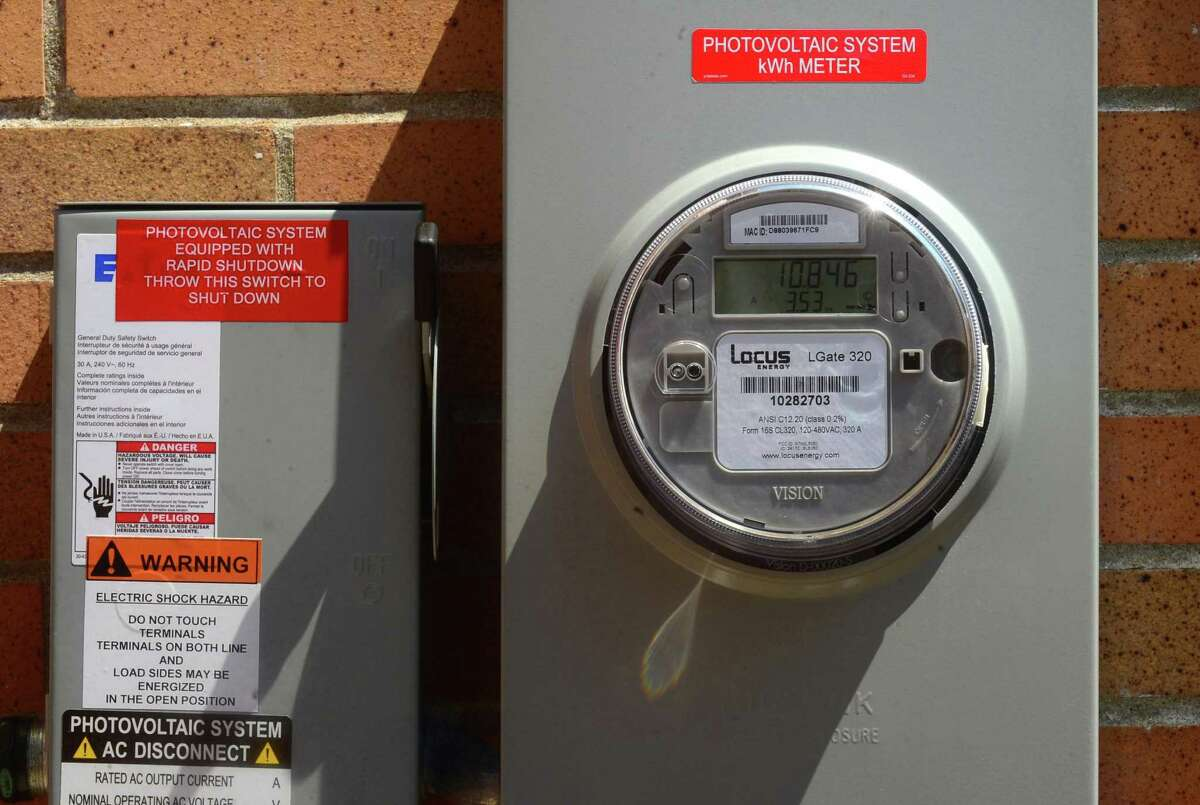 The meter runs on the the new solar panels on the bath houses at Calf Pasture Beach in Norwalk, Conn. following a press conference there announcing the installation Wednesday, July 6, 2016.