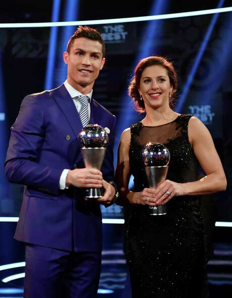 Cristiano Ronaldo (left) of Portugal and Carli Lloyd of the United States won FIFA player of the year awards Monday. Photo: Fabrice Coffrini / AFP / Getty Images / AFP or licensors