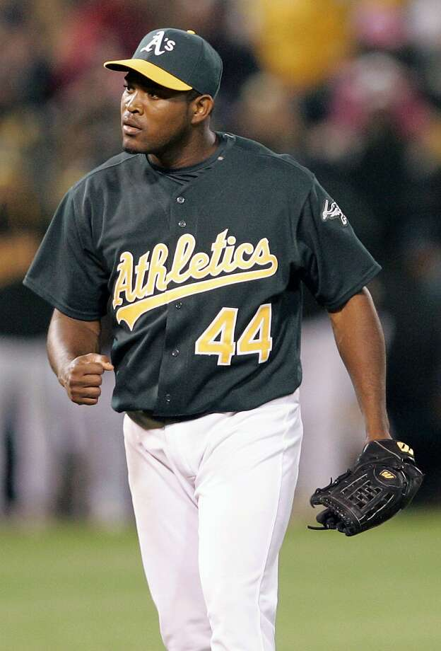 Santiago Casilla, shown here in 2007, wore the green and gold for parts of six seasons before going to the Giants. Photo: KIMBERLY WHITE, REUTERS