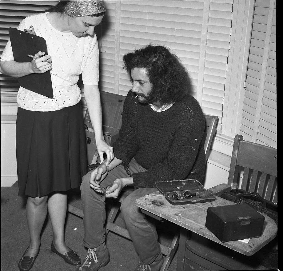Patient Bill Stabile, nurse Carmella Ranelli, and Doctor Lawrence Rose, at the Free Clinic for Hippies at the corner of Haight & Clayton in San Francisco, June 15, 1967. Photo: Photographer Unknown, The Chronicle