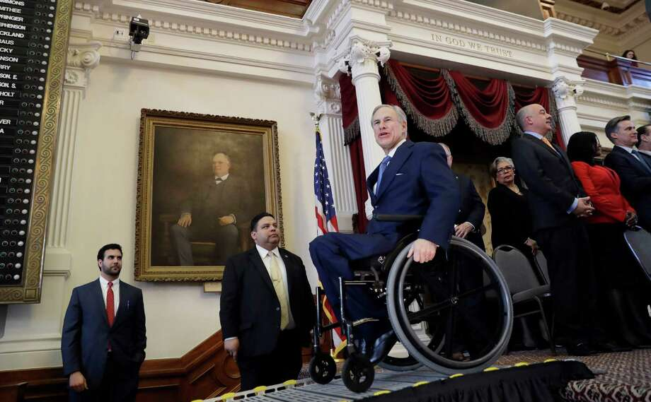 Texas Gov. Greg Abbott, center, uses a ramp to exit the House Chamber at the Texas State Capitol after he addressed the opening session of the 85th Texas Legislative session Tuesday, Jan. 10, 2017, in Austin, Texas. (AP Photo/Eric Gay) Photo: Eric Gay, STF / Copyright 2017 The Associated Press. All rights reserved.