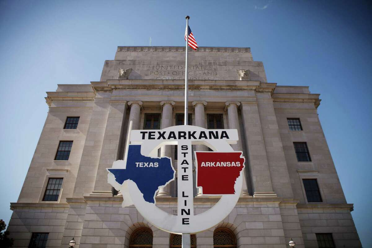 Even without a miraculous GOP replacement for Obamacare, Texas lawmakers, for our kids' sake, still can push to expand coverage by negotiating a plan with the federal government to cover workersd who don't have insurance coverage through their employers, just as Arkansas and other red states have done. The Arkansas-Texas state line runs down the middle of Stateline Avenue in Texarkana, Texas. (Michael Stravato/The New York Times)