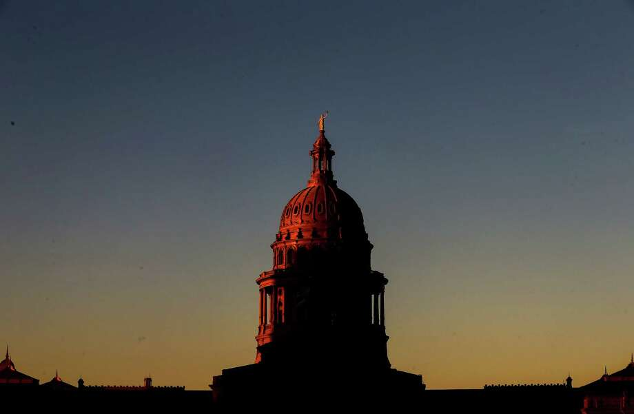 The sun sets over the Texas Capitol, Tuesday, Oct. 11, 2016, in Austin. Photo: Houston Chronicle / © 2015  Houston Chronicle