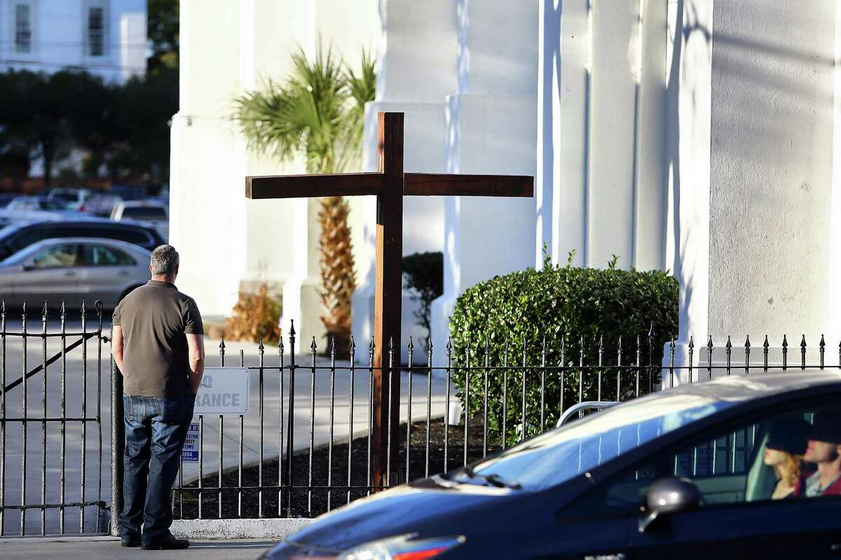 Bruce Chamberlin, on a visit from Washington, D.C., pays respects at Emanuel AME Church in Charleston, S.C., Wednesday, Jan. 11, 2017. One by one, family members of nine slain black parishioners confronted Dylann Roof for the last time Wednesday, shouting at him, offering forgiveness and even offering to visit him in prison as he awaits execution for the slaughter. (Wade Spees/The Post And Courier via AP)