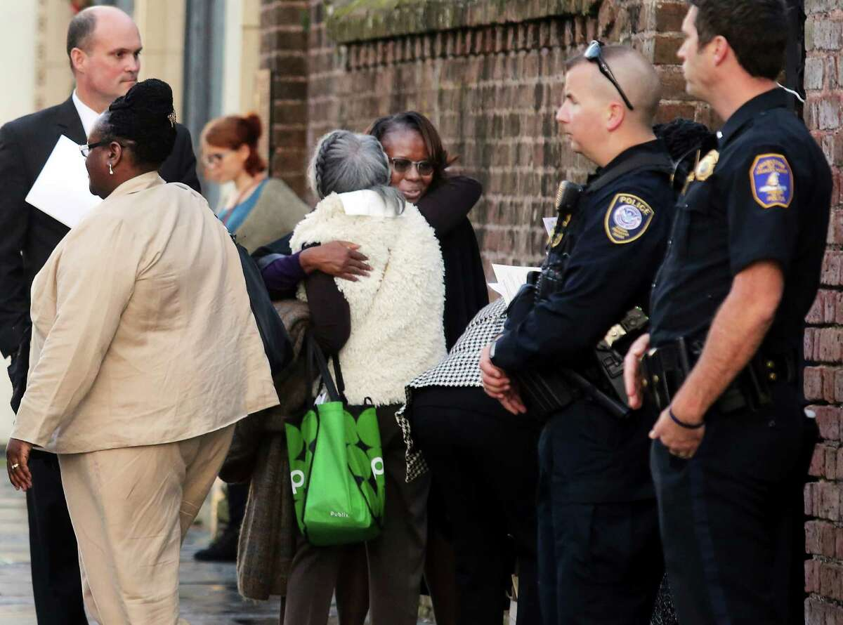 Emanuel AME shooting survivor Felicia Sanders, center, receives a hug after a short Church service for the families at St. Michaels Church across from the Federal Court in Charleston Wednesday, Jan. 11, 2017. Judge Richard Gergal sentenced Dylann Roof to death for the killing of nine worshipers at Emanuel AME Church back in June of 2015.(Brad Nettles/The Post And Courier via AP)
