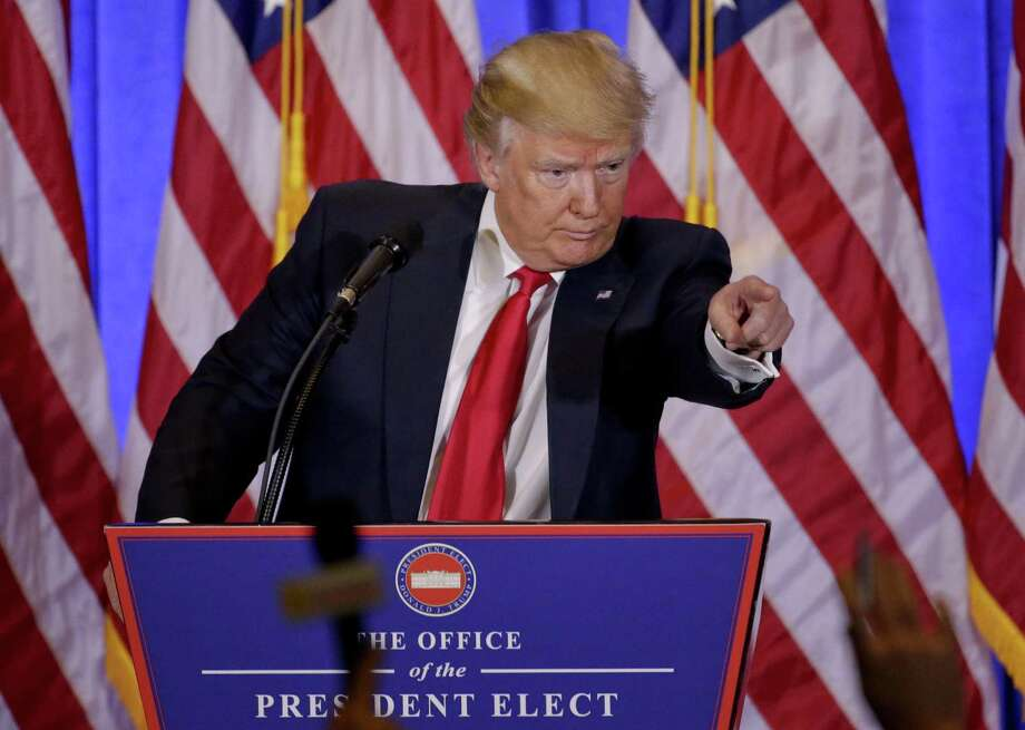 President-elect Donald Trump takes questions during a news conference, Wednesday, Jan. 11, 2017, in New York. The news conference was his first as President-elect. (AP Photo/Seth Wenig) Photo: Seth Wenig, STF / Associated Press / Copyright 2017 The Associated Press. All rights reserved.