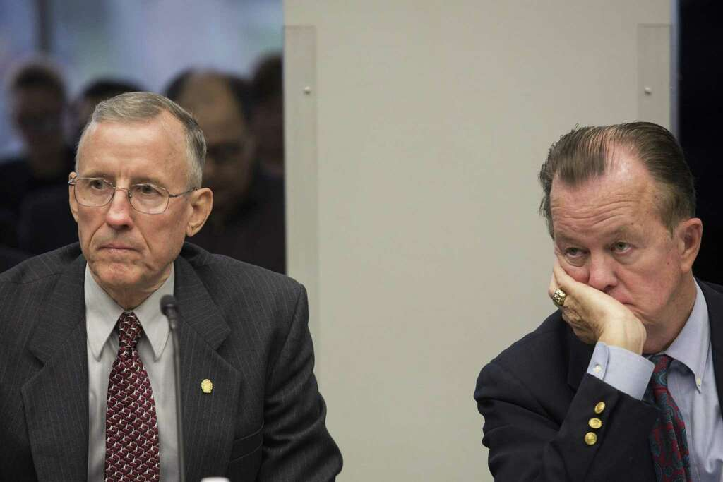 councilmen mike gallagher left and joe krier right listen during a meeting the san antonio