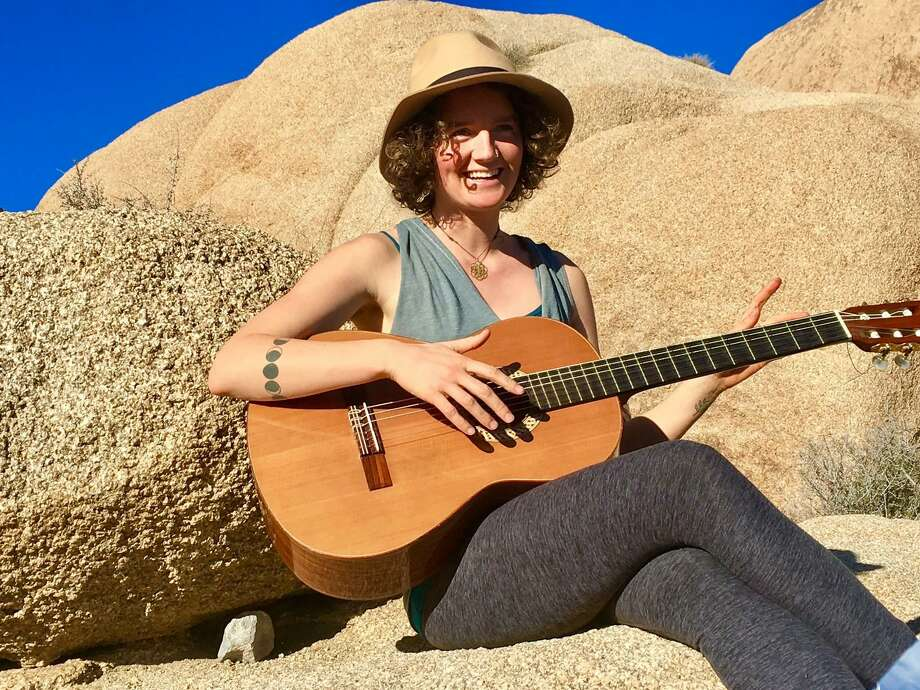 Emilie Inman, killed in a Berkeley stabbing, is seen playing guitar a few weeks ago at a campsite in Joshua Tree. Photo: Courtesy Of Lili Nakita Photography