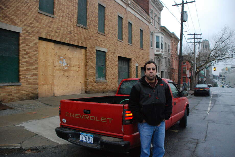 Tony Catalano, 35, stands in front of the historic firehouse on Swan Street in Albany in 2011. (Yi-Ke Peng / Times Union)