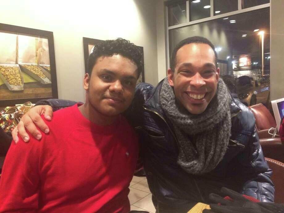 Toshan Mahabir, left, with his mentor through Capital Region Sponsor-A-Scholar, Geoff Miller. (Jennifer Patterson/Times Union)