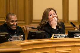 SFPD Commission President Suzy Loftus reacts to her mother Maureen Roche's public comment at City Hall in San Francisco, Calif. on Wednesday, Jan. 11, 2016. Suzy Loftus is resigning to take a job with the San Francisco Sheriff's Department.
