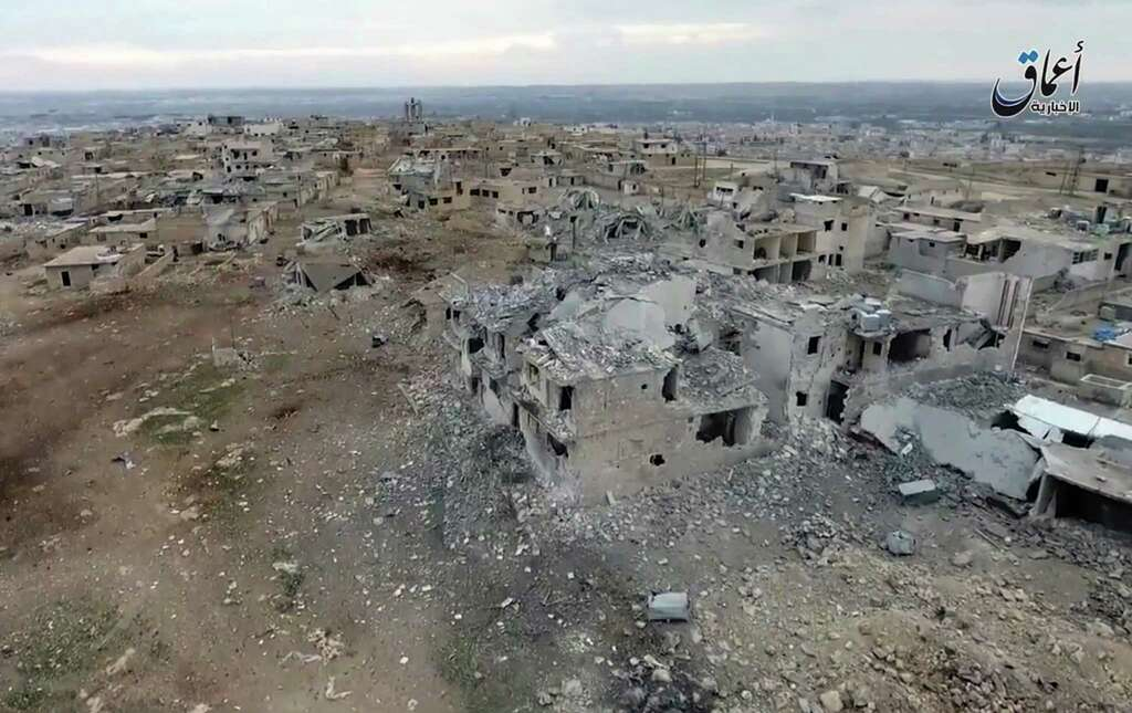 This still image taken from drone footage posted online Monday, Jan. 2, 2017 by the Aamaq News Agency, a media arm of the Islamic State group, purports to shows an aerial image of a neighborhood damaged by Turkish airstrikes in the northern Syrian town of al-Bab, in Aleppo province, Syria. Nearly two months into the assault, Turkey has become bogged down in an unexpectedly bloody fight to retake the Islamic State group's last stronghold in northern Syria. It has been forced to pour in troops, take the lead in the battle from its Syrian allies and reach out to Russia for aerial support -- a move that tests its alliance with the United States and the Syrian opposition. (Aamaq News Agency via AP) Photo: Uncredited, UGC / Amaq News Agency