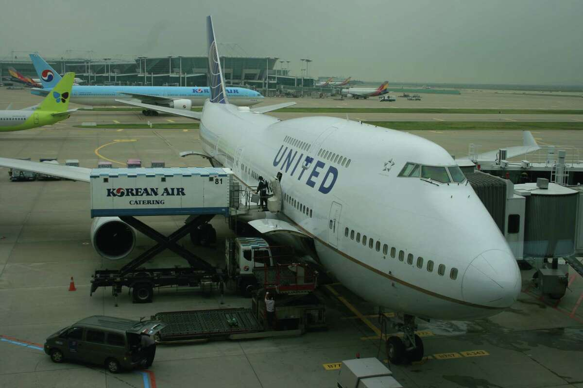 Workers prepare a United Airlines Boeing 747 for its departure from South Korea's Incheon International Airport in 2013.