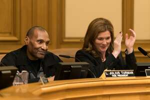 L. Julius Turman, left, celebrates being nominated to become the SFPD Commission's next president at City Hall in San Francisco, Calif. on Wednesday, Jan. 11, 2016. Suzy Loftus is resigning to take a job with the San Francisco Sheriff's Department.
