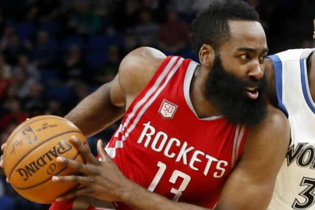 Houston Rockets' James Harden, left, drives on Minnesota Timberwolves' Kris Dunn during the second half of an NBA basketball game Wednesday, Jan. 11, 2017, in Minneapolis. The Timberwolves won 119-105. Harden led the Rockets with 33 points and 12 assists. (AP Photo/Jim Mone)