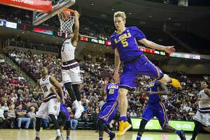Texas A&M guard Admon Gilder (3) dunks past LSU guard Kieran Hayward (5) during an NCAA college basketball game Wednesday, Jan. 11, 2017, in College Station, Texas. (Timothy Hurst/College Station Eagle via AP)