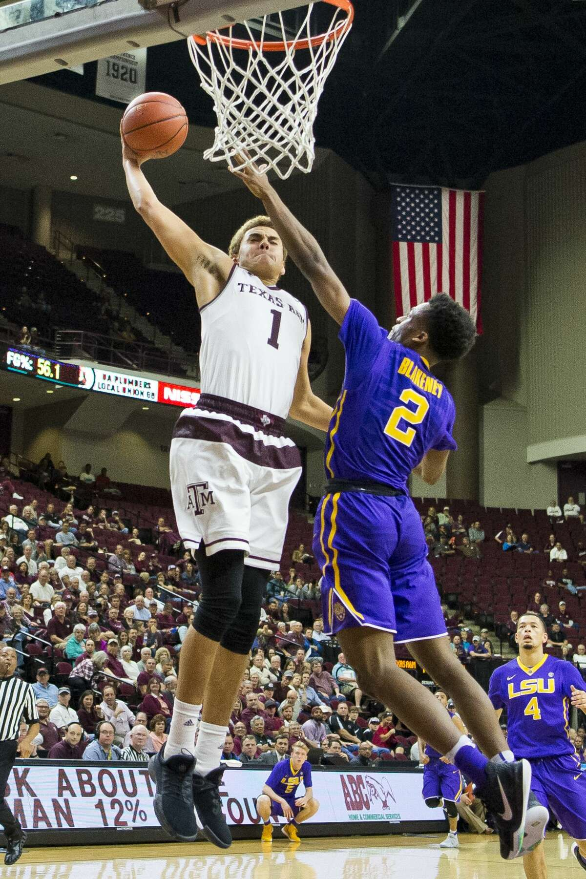 Texas A&M forward D.J. Hogg (1) dunks over LSU guard Antonio Blakeney (2) during an NCAA college basketball game Wednesday, Jan. 11, 2017, in College Station, Texas. (Timothy Hurst/College Station Eagle via AP)