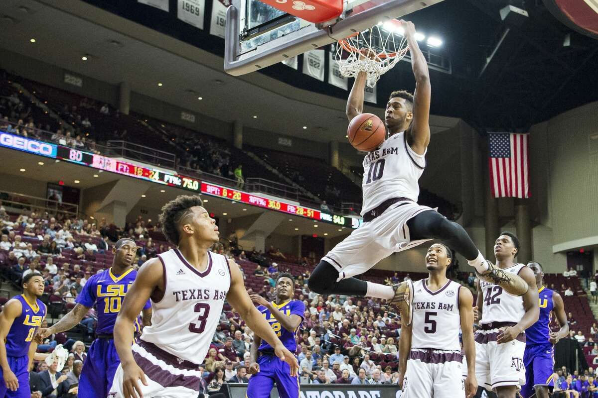Texas A&M center Tonny Troche-Morelos (10) dunks against LSU during an NCAA college basketball game Wednesday, Jan. 11, 2017, in College Station, Texas. (Timothy Hurst/College Station Eagle via AP)
