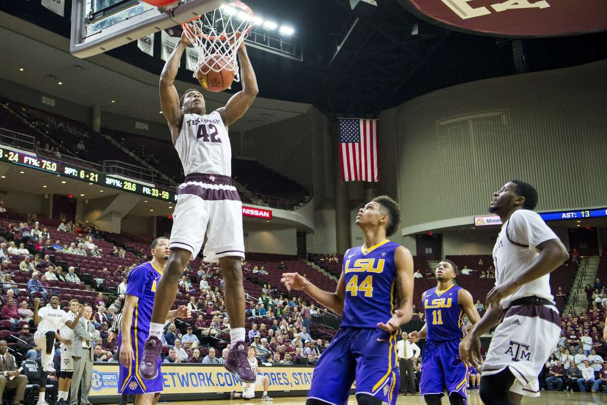 Texas A&M forward Tavario Miller (42) dunks over LSU forward Wayde Sims (44) during an NCAA college basketball game Wednesday, Jan. 11, 2017, in College Station, Texas. (Timothy Hurst/College Station Eagle via AP)