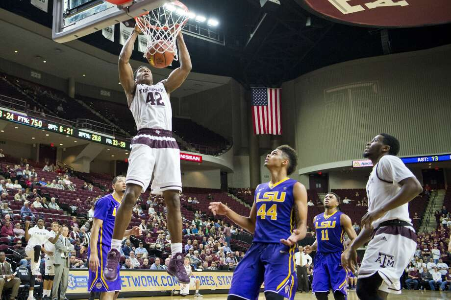 Texas A&M forward Tavario Miller (42) dunks over LSU forward Wayde Sims (44) during an NCAA college basketball game Wednesday, Jan. 11, 2017, in College Station, Texas. (Timothy Hurst/College Station Eagle via AP) Photo: Timothy Hurst/Associated Press
