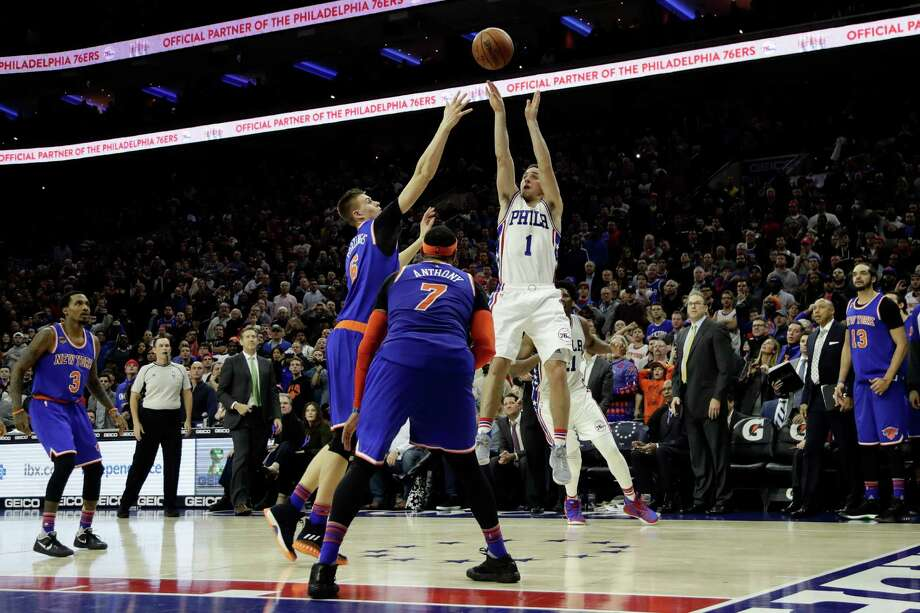 Philadelphia 76ers' T.J. McConnell (1) takes the game-winning shot against New York Knicks' Kristaps Porzingis (6) and Carmelo Anthony (7) during the final seconds of an NBA basketball game, Wednesday, Jan. 11, 2017, in Philadelphia. Philadelphia won 98-97. (AP Photo/Matt Slocum) ORG XMIT: PXC110 Photo: Matt Slocum / Copyright 2017 The Associated Press. All rights reserved.