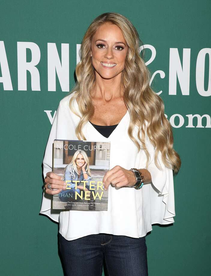 """Nicole Curtis signs copies of her new book, """"Better Than New: Lessons I've Learned from Saving Old Homes (and How They Saved Me),"""" in New York City in October. Photo: Laura Cavanaugh, Getty Images"""