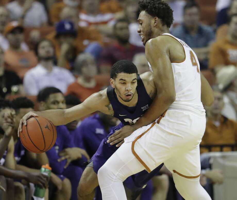 TCU guard Kenrich Williams, left, drives around Texas center James Banks (4) during the second half of an NCAA college basketball game, Wednesday, Jan. 11, 2017, in Austin, Texas. TCU won 64-61.(AP Photo/Eric Gay) Photo: Eric Gay/Associated Press