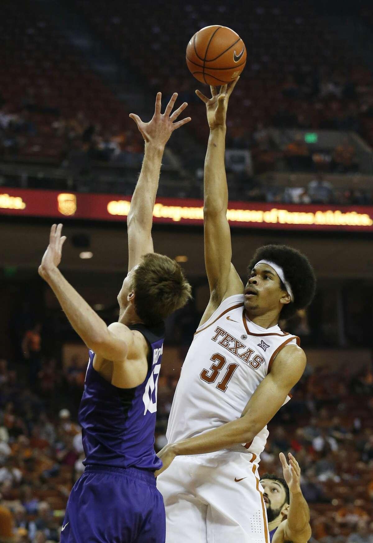 Texas' Jarrett Allen (31) shoots over TCU's Vladimir Brodziansky (10) during their game at the Frank Irwin Center in Austin on Wednesday, Jan. 11, 2017. TCU defeated Texas, 64-61.(Kin Man Hui/San Antonio Express-News)