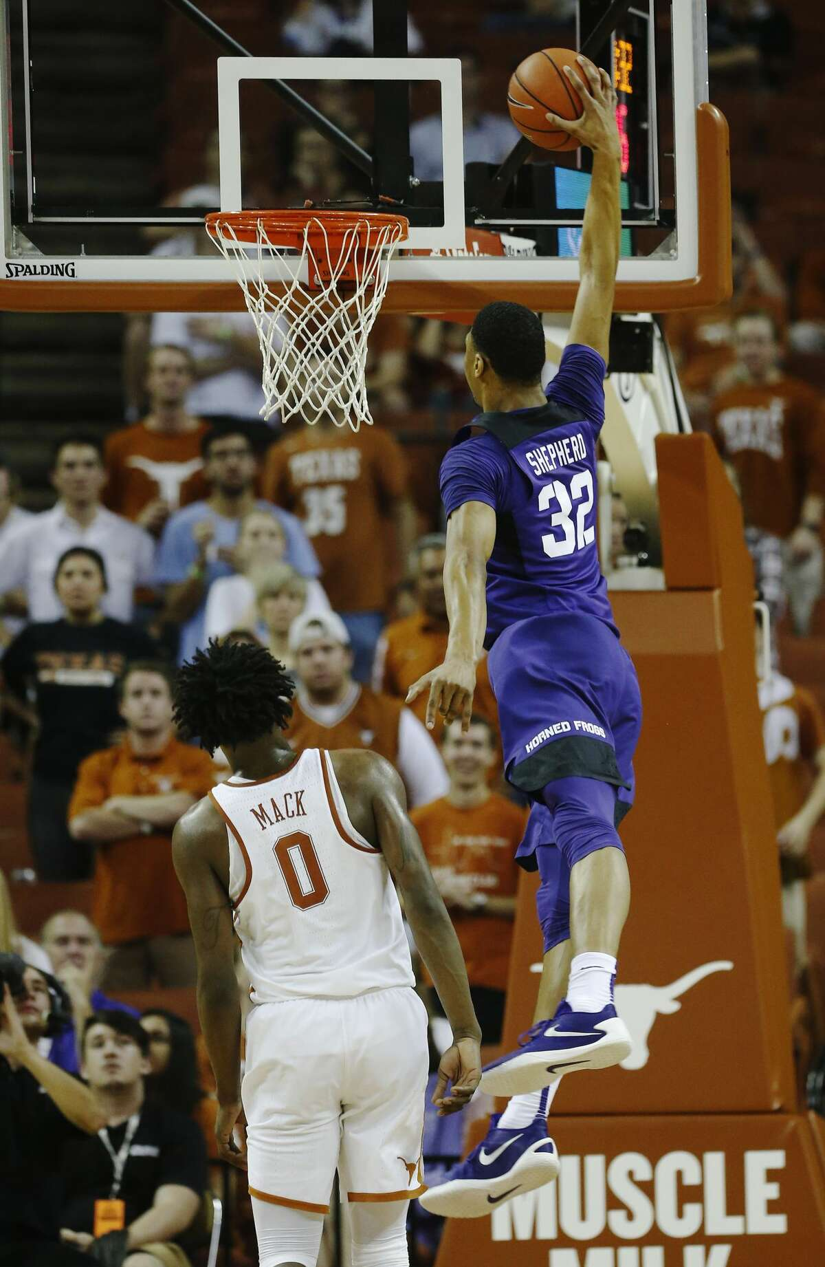 TCU's Karviar Shepherd (32) goes in for a dunk against Texas' Tevin Mack (00) during their game at the Frank Irwin Center in Austin on Wednesday, Jan. 11, 2017. TCU defeated Texas, 64-61.(Kin Man Hui/San Antonio Express-News)