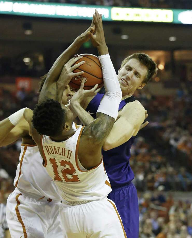 Texas' Kerwin Roach Jr. (12) defends against TCU's Vladimir Brodziansky (10) during their game at the Frank Irwin Center in Austin on Wednesday, Jan. 11, 2017. (Kin Man Hui/San Antonio Express-News) Photo: Kin Man Hui, Staff / San Antonio Express-News / ©2017 San Antonio Express-News