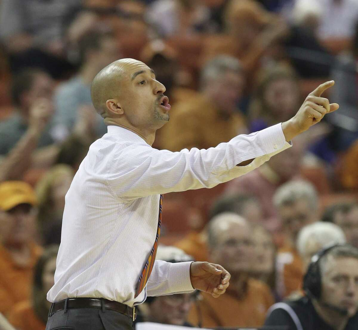 Texas coach Shaka Smart directs his team during the game against TCU at the Erwin Center in Austin on Jan. 11, 2017.