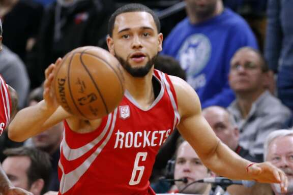 Houston Rockets' Tyler Ennis plays against the Minnesota Timberwolves during the first quarter of an NBA basketball game Wednesday, Jan. 11, 2017, in Minneapolis. (AP Photo/Jim Mone)