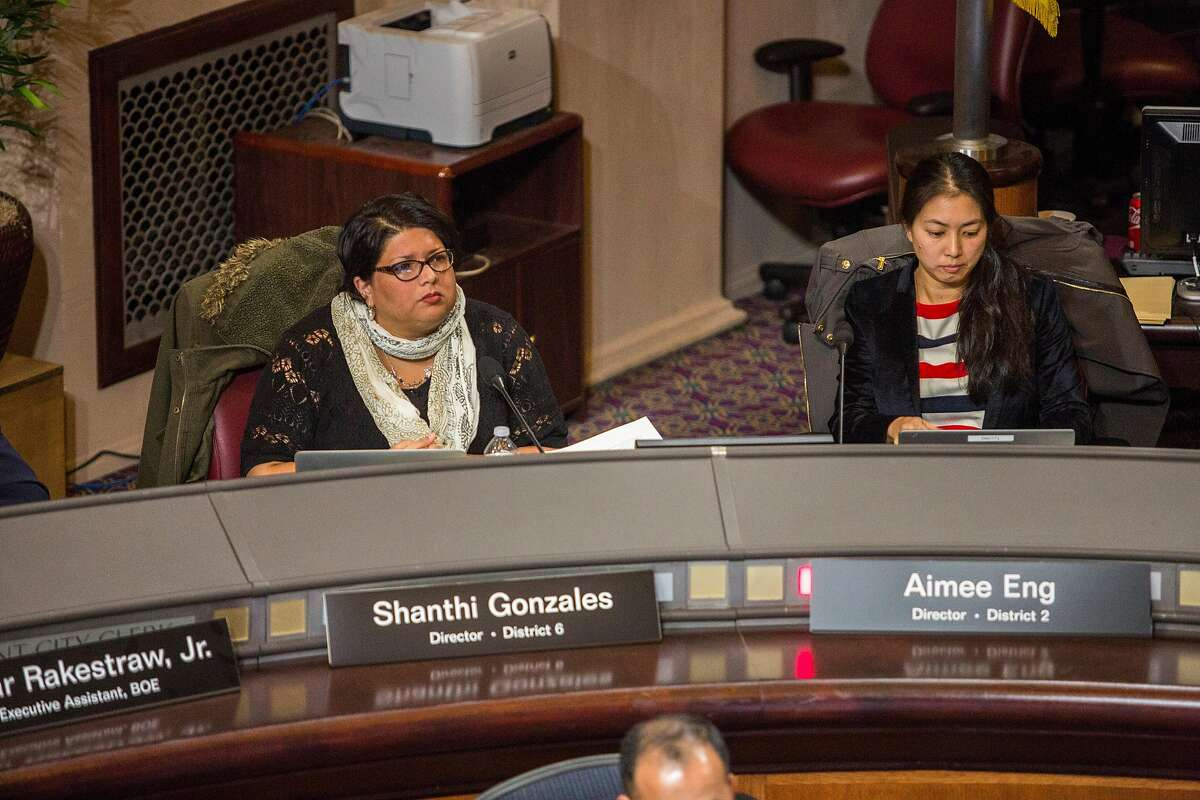 District six director Shanthi Gonzales, left, and district 2 director Aimee Eng during a meeting of the Oakland Unified School District Board of Education meeting, Wednesday, Jan. 11, 2017 in Oakland, CA.