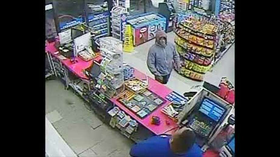 Police are trying to identify two men who allegedly robbed a local business at knifepoint. Photo: Courtesy Photo