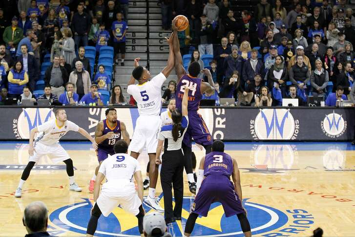 SANTA CRUZ - DECEMBER 16:  Damian Jones #5 of the Santa Cruz Warriors and Johnny O'Bryant III #24 of the Northern Arizona Suns go up for the opening tip off before the game on December 16, 2016 at Kaiser Permanente Arena in Santa Cruz, California. NOTE TO USER: User expressly acknowledges and agrees that, by downloading and/or using this Photograph, user is consenting to the terms and conditions of the Getty Images License Agreement. Mandatory Copyright Notice: Copyright 2016 NBAE (Photo by Jack Arent/NBAE via Getty Images)