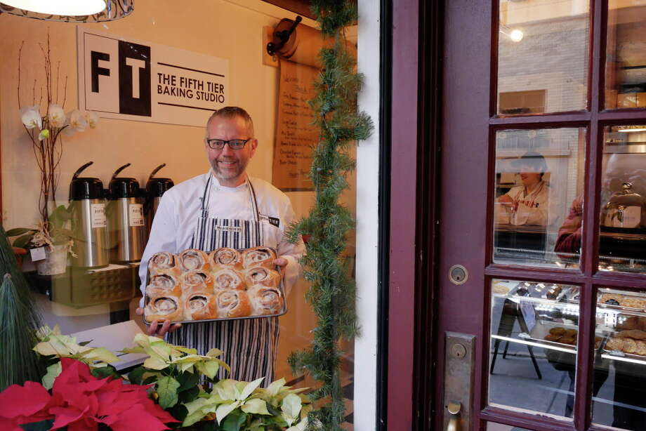 Lyle Houston, the proprietor of The Fifth Tier Baking Studio, poses inside his business with a tray of cinnamon rolls on Thursday, Jan. 5, 2017, in Albany, N.Y.  (Paul Buckowski / Times Union) Photo: PAUL BUCKOWSKI, Albany Times Union / 20039318A