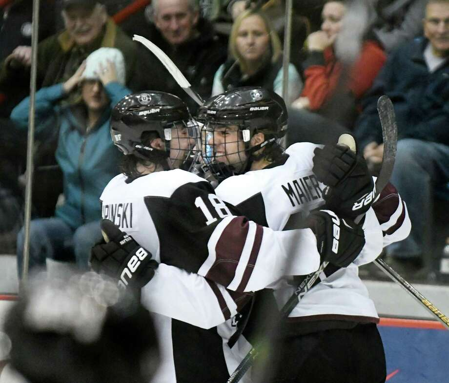 Union's Cole Maier, right, celebrates his fourth-period goal with teammate Brett Supinski during their hockey game on Friday, Oct. 28, 2016, at Houston Field House in Troy, N.Y. (Cindy Schultz / Times Union) Photo: Cindy Schultz / Albany Times Union