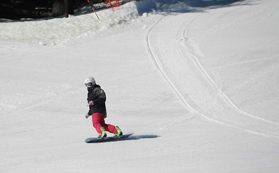 A snowboarder rides down a slope at Willard Mountain on Friday, Feb. 26, 2016 in Greenwich, N.Y. (Lori Van Buren / Times Union) Photo: Lori Van Buren / 10035594A