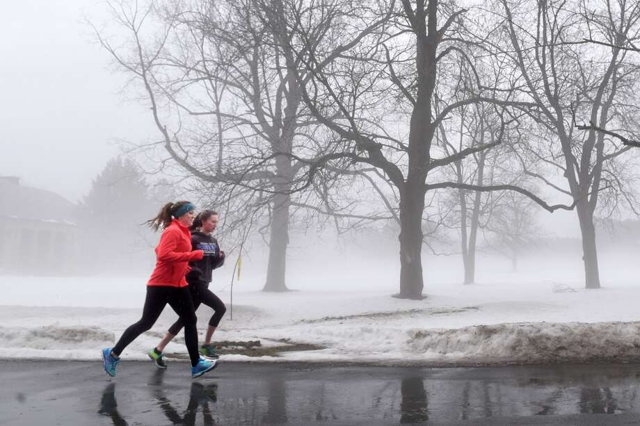 Sara Billings, left, and Jackie Boyce take a morning run Thursday, Jan. 12, 2017, through a foggy Saratoga Spa State Park in Saratoga Springs, N.Y. (John Carl D'Annibale / Times Union) Photo: John Carl D'Annibale